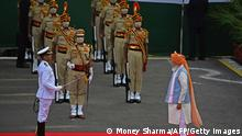 Indias Prime Minister Narendra Modi (R) inspects a guard of honour before addressing the nation from the ramparts of the Red Fort during the celebrations to mark countrys 75th Independence Day in New Delhi on August 15, 2021. (Photo by Money SHARMA / AFP) (Photo by MONEY SHARMA/AFP via Getty Images)