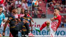 Mainz's Paul Nebel, right, and Leipzig's Mohamed Simakan fight for the ball during the German Bundesliga soccer match between FSV Mainz 05 and RB Leipzig in Mainz, Germany, Sunday, Aug.15, 2021. (AP Photo/Michael Probst)
