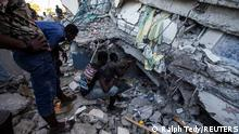 People look for survivors at a house destroyed following a 7.2 magnitude earthquake in Les Cayes, Haiti August 14, 2021. REUTERS/Ralph Tedy Erol NO RESALES. NO ARCHIVES