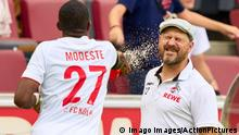 Anthony MODESTE, 1.FCK 27 celebrate goal of Florian KAINZ, 1.FCK 11 2-1 and covers Steffen Baumgart, 1.FCK Trainer with water in the match 1.FC KÖLN - HERTHA BSC BERLIN 1.German Football League on August 15, 2021 in Cologne, Germany Season 2020/2021, matchday 1, 1.Bundesliga, 1.Spieltag,