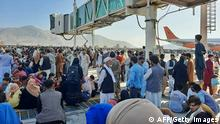 TOPSHOT - Afghans crowd at the tarmac of the Kabul airport on August 16, 2021, to flee the country as the Taliban were in control of Afghanistan after President Ashraf Ghani fled the country and conceded the insurgents had won the 20-year war. (Photo by - / AFP) (Photo by -/AFP via Getty Images)