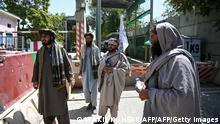 Taliban fighters stand guard at an entrance of the green zone area in Kabul on August 16, 2021, after a stunningly swift end to Afghanistan's 20-year war, as thousands of people mobbed the city's airport trying to flee the group's feared hardline brand of Islamist rule. (Photo by Wakil Kohsar / AFP) (Photo by WAKIL KOHSAR/AFP via Getty Images)