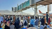 Afghans crowd at the tarmac of the Kabul airport on August 16, 2021, to flee the country as the Taliban were in control of Afghanistan after President Ashraf Ghani fled the country and conceded the insurgents had won the 20-year war. (Photo by - / AFP)