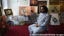 29.08.2019 In this photograph taken on August 29, 2019, Afghan co-founder and president of ArtLords Omaid Sharifi, 32, speaks during an interview with AFP at his studio in Kabul. - Omaid Sharifi, who heads a Kabul-based art collective, sits in his studio and leafs through a stack of dozens of hand-written letters, reading out sentences at random. The letters are the fruit of a recent initiative by ArtLords, a not-for-profit group that Sharifi co-founded and runs, which aims to give a voice to young Afghans who feel ignored and powerless as the war rages on. (Photo by Wakil KOHSAR / AFP) / To go with 'AFGHANISTAN-CONFLICT-YOUTH-PEACE' FOCUS by Thomas WATKINS (Photo credit should read WAKIL KOHSAR/AFP via Getty Images)