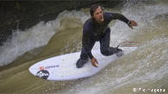 Carsten Kurmis rides a wive in the Eisbach in Munich