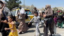 Women with their children try to get inside Hamid Karzai International Airport in Kabul, Afghanistan August 16, 2021. REUTERS/Stringer NO RESALES. NO ARCHIVES