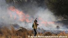 KERAETA, GREECE - AUGUST 16: Firefighters respond to the forest fire that broke out in Markati village of Keratea town near Athens, in Greece on August 16, 2021. Officials said 10 houses have burned in the fire. Ayhan Mehmet / Anadolu Agency