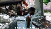 A collapsed home lays in ruins in Saint-Louis-du-Sud, Haiti, Monday, Aug. 16, 2021, two days after a 7.2-magnitude earthquake struck the southwestern part of the country. (AP Photo/Matias Delacroix)