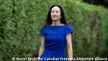 Meng Wanzhou, chief financial officer of Huawei, leaves home to attend her extradition hearing at B.C. Supreme Court, in Vancouver, on Monday, August 16, 2021. (Darryl Dyck/The Canadian Press via AP)