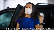 Meng Wanzhou, chief financial officer of Huawei, arrives at B.C. Supreme Court to attend her extradition hearing, in Vancouver, on Monday, August 16, 2021. (Darryl Dyck/The Canadian Press via AP)