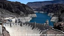 June 11, 2021 - LAKE MEAD NRA U.S. - Hoover Dam is seen on the border between Arizona and Nevada. Hoover Dam, completed in 1936, impounds Lake Mead, the largest reservoir in the United States by volume. Almost the entire Southwest of the United States is mired in various stages of drought, resulting in falling water levels at the nation's two largest reservoirs, Lake Mead and Lake Powell. The white ''bathtub ring'' on the rocks is from mineral deposits left by higher levels of water. (Credit Image: © David Becker/ZUMA Wire