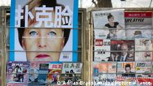 epa03031568 A magazine cover depicting German Chancellor Angela Merkel with the phrase 'Poker Face' looms over a news stand in central Beijing, China, 12 December 2011. China's role in helping the European Union stabilise remains a hotly debated topic both in China and elsewhere. EPA/ADRIAN BRADSHAW ++ +++ dpa-Bildfunk +++
