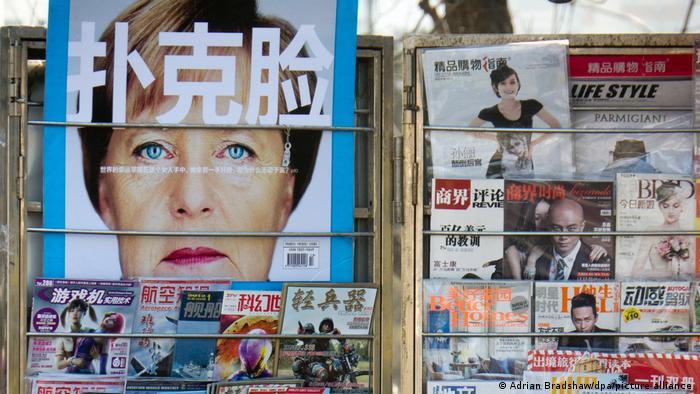 Merkel's face on a Chinese-language magazine