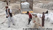 epa03823072 Afghans laborers collect salt from salt mines in Namak Aab district of Takhar province, Afghanistan, 13 August 2013. According to media reports, Afghanistan has nearly one trillion dollars in untouched mineral deposits including lithium, iron, copper, cobalt and gold, referring to US government estimates. The deposits could turn Afghanistan into one of the most important mining centres in the world. However, with almost no mining industry infrastructure in place, it would take Afghanistan decades to fully exploit the mineral reserves. EPA/JAWED KARGAR ++ +++ dpa-Bildfunk +++