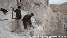 epa03823074 Afghans laborers collect salt from Salt mines in Namak Aab district of Takhar province, Afghanistan, 13 August 2013. According to media reports, Afghanistan has nearly one trillion dollars in untouched mineral deposits including lithium, iron, copper, cobalt and gold, referring to US government estimates. The deposits could turn Afghanistan into one of the most important mining centres in the world. However, with almost no mining industry infrastructure in place, it would take Afghanistan decades to fully exploit the mineral reserves. EPA/JAWED KARGAR EPA/JAWED KARGAR ++ +++ dpa-Bildfunk +++