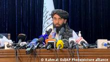 """Taliban spokesman Zabihullah Mujahid speaks at at his first news conference in Kabul, Afghanistan, Tuesday, Aug. 17, 2021. For years, Mujahid had been a shadowy figure issuing statements on behalf of the militants. On Tuesday he said the insurgents sought no revenge and that """"everyone is forgiven."""" (AP Photo/Rahmat Gul)"""
