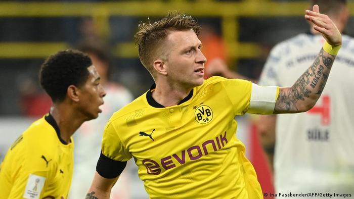 Marco Reus rouses the Südtribune after scoring Dortmund's goal.