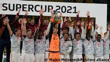 Players of Bayern Munich celebrate after winning the German Supercup soccer match between Borussia Dortmund and Bayern Munich in Dortmund, Germany, Tuesday, Aug. 17, 2021. (AP Photo/Martin Meissner)