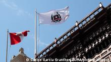 December 7, 2018 - Lima, Lima, Peru - Flag of Peru and flag of the Peruvian Diplomatic Service waving on top of the Torre Tagle palace, headquarters of the Peruvian Chancellery