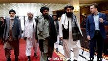 MOSCOW, RUSSIA - MARCH 19: Taliban delegation headed by Abdul Ghani Baradar (R3) and Sher Mohammad Abbas Stanikzai (L) are seen leaving the hotel after attending the meeting on Afghan peace with the participation of delegations from Russia, China, the US, Pakistan, and Afghan parties and Qatar as an honorary guest in Moscow, Russia on March 19, 2021. Sefa Karacan / Anadolu Agency