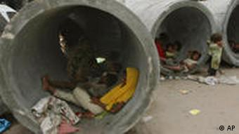 People in Karachi's slums have taken refuge in huge concrete pipes