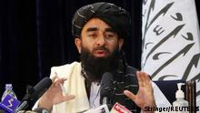 Taliban spokesman Zabihullah Mujahid speaks during a news conference in Kabul, Afghanistan August 17, 2021. REUTERS/Stringer NO RESALES. NO ARCHIVES