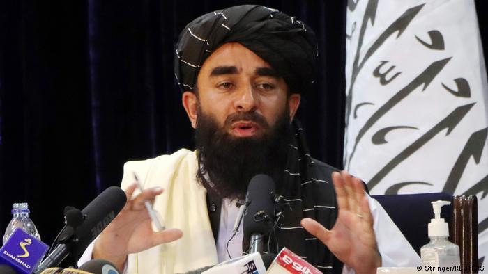 یکی از سخنگویان رسمی طالبان است. او در ۱۷ اوت سال ۲۰۲۱ چهره خود را به عموم مردم نشان داد. او پس از دستگیری محمد حنیف در سال ۲۰۰۷ سخنگوی طالبان شد و بهطور منظم با روزنامهنگاران از طریق تماسهای تلفنی، پیامک، ایمیل، توییتر و پستهایش در وبسایتهای جهادی ارتباط بر قرار میکرد. او مسئول تأیید یا رد حملات طالبان در سراسر افغانستان است.