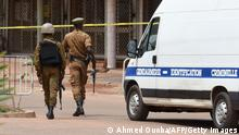 Security personnel prepare to lift a tape cordonning off an area to let a Gendarmerie vehicle through close to the site of a terrorist attack in Ouagadougou on August 15, 2017. Eighteen people, including at least eight foreigners were shot dead in a Turkish restaurant in Burkina Faso, according to a provisional toll, in the latest attack in West Africa to target a spot popular with expatriates. There has been no claim of responsibility for the attack laye August 13, at the Aziz Istanbul restaurant, which is often packed with foreign nationals who go there to watch television coverage of football. / AFP PHOTO / SIA KAMBOU (Photo credit should read SIA KAMBOU/AFP via Getty Images)