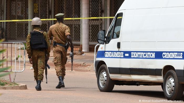 Security personnel and a gendarmerie vehicle after a terrorist attack in Ouagadougou