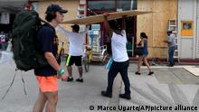 Workers cover shop windows with plywood in Tulum, Quintana Roo State, Mexico, Wednesday, Aug. 18, 2021. Residents and tourists along the Caribbean coast began making preparations for Grace, a storm that drenched Haiti and Jamaica and is now forecast to hit Mexico´s Yucatan peninsula like a hurricane early Thursday morning. (AP Photo/Marco Ugarte)