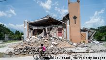 The Church St Anne is seen completely destroyed by the earthquake in Chardonnieres, Haiti on August 18, 2021. - The death toll from a 7.2 magnitude earthquake that struck Haiti has risen to 1,941, the Caribbean nation's civil protection agency said Tuesday, as a tropical storm brought torrential downpours on survivors already coping with catastrophe. More than 9,900 people were wounded when the quake struck the southwestern part of the Caribbean nation on Saturday, about 100 miles (160 kilometers) to the west of the capital Port-au-Prince, according to the updated toll. (Photo by Reginald LOUISSAINT JR / AFP) (Photo by REGINALD LOUISSAINT JR/AFP via Getty Images)