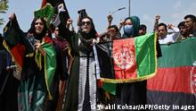 TOPSHOT - Afghans celebrate the 102th Independence Day of Afghanistan with the national flag in Kabul on August 19, 2021. (Photo by WAKIL KOHSAR / AFP) (Photo by WAKIL KOHSAR/AFP via Getty Images)
