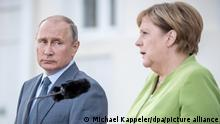 18 August 2018, Germany, Meseberg: German Chancellor Angela Merkel of the Christian Democratic Union (CDU) meets Russian President Vladimir Putin at Meseberg Palace. Photo: Michael Kappeler/dpa