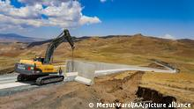 VAN, TURKEY - JULY 17: A heavy duty machine works on the 3-kilometer section of the 63-kilometer modular concrete wall, which was started to be built on the Iranian border line in order to prevent illegal immigration, smuggling activities and prevent PKK, (listed as a terrorist organization by Turkey, the U.S. and the EU), from infiltrating the country in Van, Turkey on July 17, 2021. Mesut Varol / Anadolu Agency