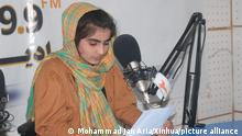 (210420) -- SHIBERGHAN, April 20, 2021 (Xinhua) -- An Afghan female journalist hosts a radio program at the radio-television channel Ghazal in Shiberghan city, capital of Jawzjan province, Afghanistan, April 7, 2021. TO GO WITH Feature: Afghan female journalist defies security threats, launches news channel (Photo by Mohammad Jan Aria/Xinhua)