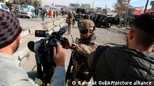 Afghan security police block a TV journalist from filming at the site of bombing attack in Kabul, Afghanistan, Feb. 10, 2021. The coordinated killings in Jalalabad on Tuesday, March 2, 2021, of three women working for a local radio and TV station in Jalalabad were the latest in a bloody campaign against journalists in Afghanistan, a country that was already considered one of the most dangerous places in the world to be a journalist. In just the last six months, 15 journalists have been killed in a series of targeted killings. (AP Photo/Rahmat Gul)