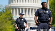 U.S. Capitol Police officers stand at an intersection near the U.S. Capitol and a Library of Congress building in Washington on Thursday, Aug. 19, 2021, as law enforcement investigate a report of a possible explosive device in a pickup truck outside the Library of Congress on Capitol Hill and have evacuated have evacuated multiple buildings on the sprawling Capitol complex. (AP Photo/Patrick Semansky)