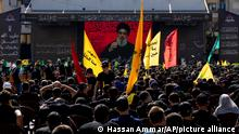 Hezbollah supporters listen to their leader Sayyed Hassan Nasrallah as he speaks via a video link during Ashoura, the Shiite Muslim commemoration marking the death of Immam Hussein, the grandson of the Prophet Muhammad, at the Battle of Karbala in present-day Iraq in the 7th century, in southern Beirut, Lebanon, Thursday, Aug. 19, 2021. The leader of the militant Hezbollah group Sayyed Hassan Nasrallah said Thursday that the first Iranian fuel tanker will sail toward Lebanon within hours warning Israel and the United States not to intercept it. (AP Photo/ Hassan Ammar)
