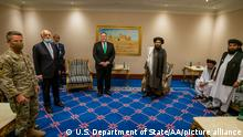 DOHA, QATAR - SEPTEMBER 12: (----EDITORIAL USE ONLY – MANDATORY CREDIT - US DEPARTMENT OF STATE / HANDOUT - NO MARKETING NO ADVERTISING CAMPAIGNS - DISTRIBUTED AS A SERVICE TO CLIENTS----) U.S. Secretary of State Michael R. Pompeo meets with the Taliban political affairs chief Mullah Abdul Ghani Baradar in Doha, Qatar, on September 12, 2020. U.S. Department of State/Handout / Anadolu Agency