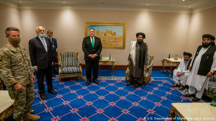 Former U.S. Secretary of State Mike Pompeo with the Taliban's political chief Mullah Baradar in Doha in 2020