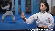 Meena Asadi, a 28-year-old former Afghan martial arts athlete practices karate at the Refugee Shotokan Club dojo in Cisarua, West Java province, Indonesia, August 18, 2021. Picture taken August 18, 2021. REUTERS/Ajeng Dinar Ulfiana