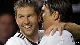 Germany's Thomas Hitzlsperger, left, and Mario Gomez celebrate after scoring
