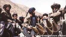 Taliban fighters seen near Kabul Thursday, Oct. 3, 1996. The Taliban, an Islamic fundamentalist army, took over Kabul and drove out forces loyal to President Burhanuddin Rabbani a week ago. Taliban forces now control most of Afghanistan. In the first new reports of fresh fighting since Taliban rebels took over Kabul on Sept. 28, witnesses said they saw hundreds of the fighters clamboring up the rugged mountains overlooking the Panjshir Valley.(AP Photo/Hurriyet) -- TURKEY OUT --