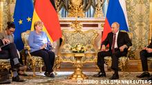 Russian President Vladimir Putin receives German Chancellor Angela Merkel at the Kremlin in Moscow, Russia August 20, 2021. Guido Bergmann/BPA/Handout via REUTERS ATTENTION EDITORS - THIS IMAGE HAS BEEN SUPPLIED BY A THIRD PARTY NO RESALES. NO ARCHIVES