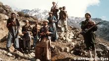 This picture taken in the early 80s shows the premier groups of the Afghan anti-Soviet resistance fighters with their primitive arms in the eastern parts of the country. The Afghans repulsed the then Red Army 1979-1989 invasion with a huge human cost and with the material aid of the western wolrd, above all, the United States. Easy estimates say that around one and half million Afghans were killed in their fight against the Soviet soldiers. AFP PHOTO (Photo credit should read /AFP via Getty Images)