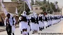 Taliban fighters march in uniforms on the street in Qalat, Zabul Province, Afghanistan, in this still image taken from social media video uploaded August 19, 2021 and obtained by REUTERS THIS IMAGE HAS BEEN SUPPLIED BY A THIRD PARTY.