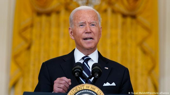 President Joe Biden speaks from the White House East Room
