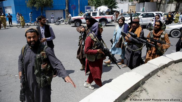 Taliban fighters with weapons in the streets of Kabul