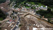 TOPSHOT - An aerial view taken on August 19, 2021 shows a landfill (bottom R) with debris in Altenahr, Rhineland-Palatinate, western Germany, weeks after heavy rain and floods caused major damage in the Ahr region. - Deadly floods in mid-July washed away homes, businesses and critical infrastructure, with the states of Rhineland-Palatinate and North Rhine-Westphalia worst hit. (Photo by Ina FASSBENDER / AFP)