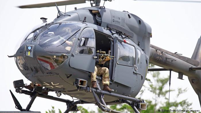 Photo of Bundeswehr Airbus H145M with an armed soldier in the side door